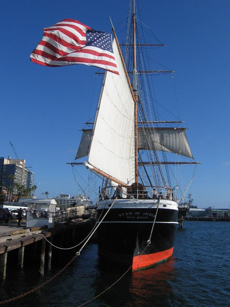 The stern of our beautiful Star of India. A large American flag billows in the sea breeze.