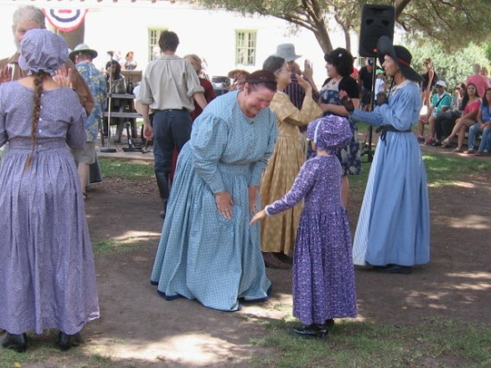 Two ladies prepare to dance the polka.