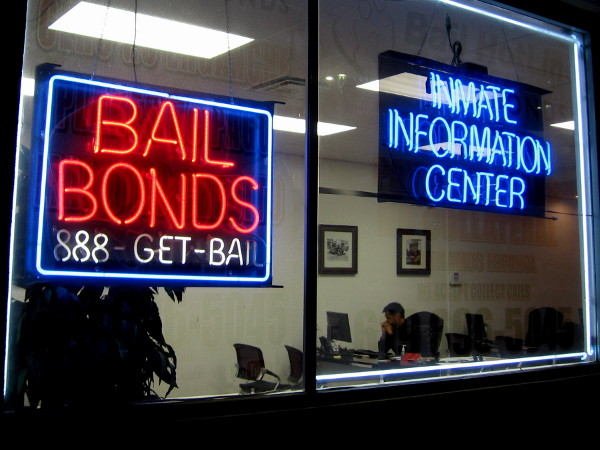 Glowing neon Bail Bonds advertisement at this open-all-night Inmate Information Center.