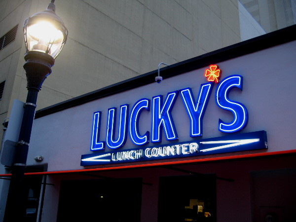 Lucky's Lunch Counter has a unique sign that really stands out.