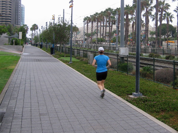 A lone jogger heads down Martin Luther King Jr. Promenade while many San Diegans are still in bed.