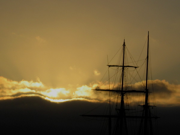 Masts of tall ship Californian, of the Maritime Museum of San Diego, and a brilliant sunset. Unlike a fictional whale, these beautiful things are quite easily seen.