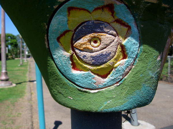 Ceramic eye atop parking lot post at north end of Balboa Park's art-filled Spanish Village. Various faces and fun eyeballs decorate several nearby posts.