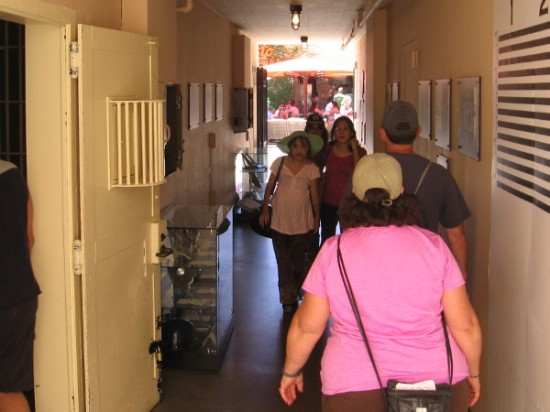 People view photos and memorabilia in corridor of the old San Diego Police Headquarters located downtown near Seaport Village.