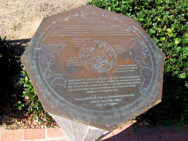 Pearl of the Pacific Park plaque describes tile images and their meaning.