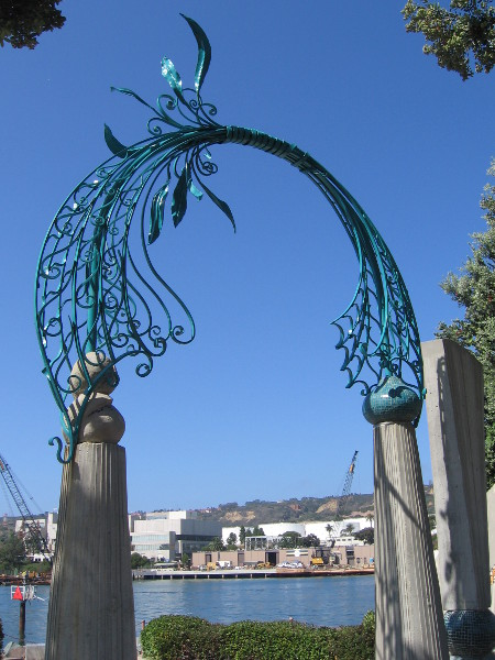 A soaring sculptural arch made of beautiful ironwork.