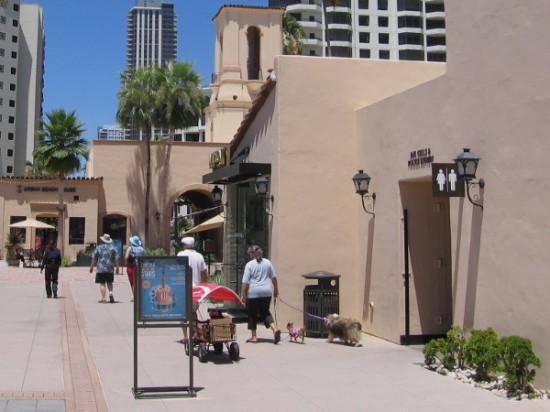 People amble past a doorway which leads into the past. A bit of San Diego history beckons the curious.