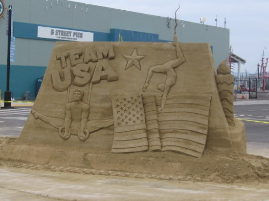 Team USA, American Olympic gymnasts and a United States flag decorates one side of a sand sculpture at the foot of the B Street Pier in San Diego!
