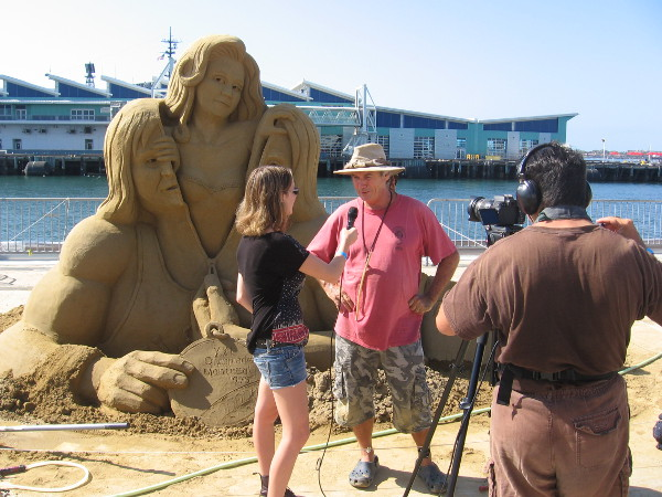 John Gowdy is interviewed by a video production crew at the 2015 U.S. Sand Sculpting Challenge.