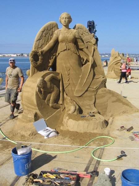Ilya Filimontsev's sculpture is titled Never Give Up!!! Wow! Now that's an impressive sand sculpture. And he wasn't finished!