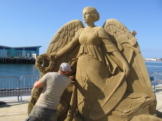 Carefully working beneath a wing and Olympic olive wreath on a sunny San Diego Labor Day weekend.