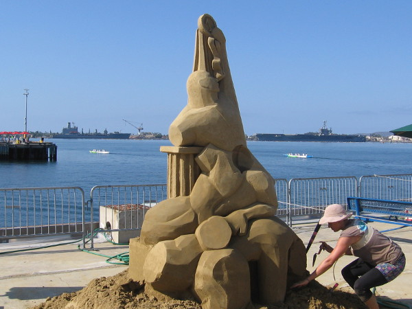 Morgan Rudluff's sand sculpture is Perseverance. It appears to be a tower of Greek columns and abstract human forms.