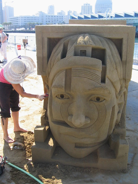 An interesting face decorates one end of the complicated multi-part sand sculpture.