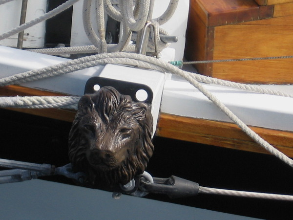 Lion's head decorates spar projecting from hull of topsail schooner Amazing Grace.