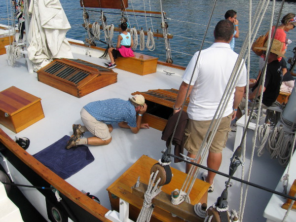 Visitor at 2015 Festival of Sail in San Diego looks down into the cabin of Amazing Grace.