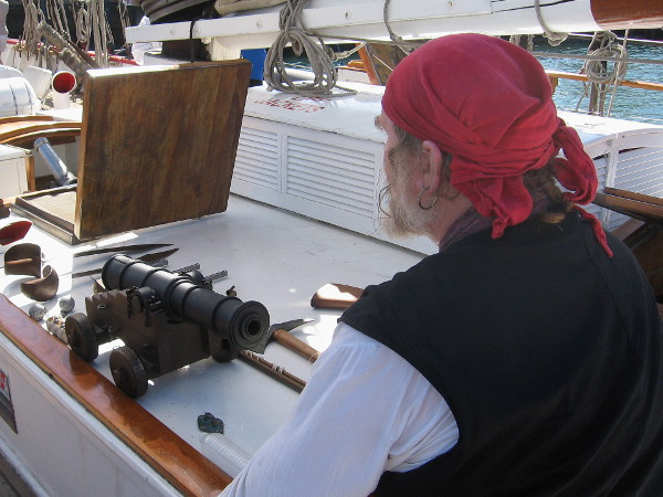 Bill of Rights tall ship crew members were dressed in seafaring costumes. This pirate had a collection of pistols and a small cannon on display.