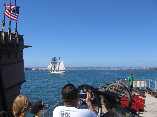 A land battery took part during the festival's cannon battles. A beautiful tall ship heads across the bay.