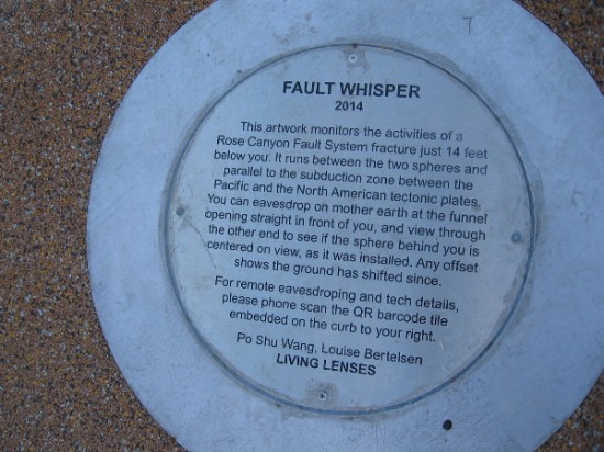 Plaque describes Fault Whisper public art, created by Po Shu Wang in 2014. Two spheres stand on either side of the fault line. From one you can listen to the Earth and monitor movement.