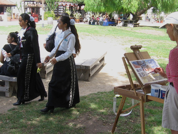 Someone paints during the lively festival. Historic Old Town is a picturesque place that inspires artists, at any time!