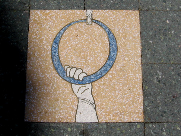 This outdoor public art titled The Circle and the Self tells the story of human athletic pursuit and competitive sport. Each tile measures 16 by 16 inches square.