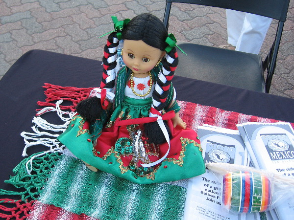 Doll greets visitors at Friday evening House of Mexico event in Balboa Park.