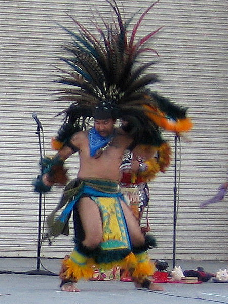 Performer from Danza Azteca Calpulli Mexihca in colorful Aztec costume.
