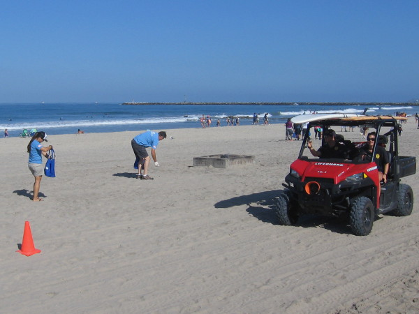 The friendly lifeguards were cruising along the sand making sure everyone enjoying the warm water was safe.