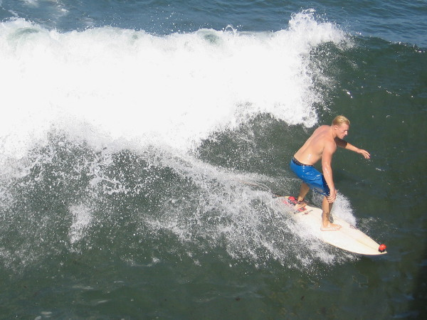 This surf dude caught himself a sweet liquid ride!