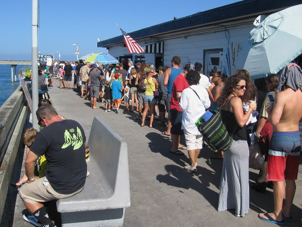 A long line of hungry folks waits near the much-beloved Ocean Beach pier cafe, which has been a cool place to go for many years.