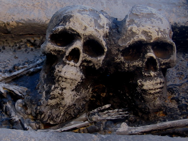 Creepy skulls await visitors near entrance to The Haunted Trail for the approaching Halloween season.