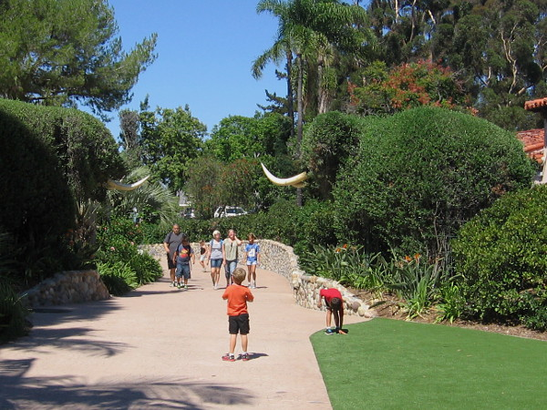 Two huge shrub elephants guard a path at the west edge of Spanish Village. Walk north and you'll arrive at the world famous San Diego Zoo!