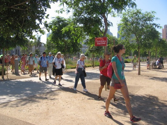 And here they come! Guides with Trolley Dances signs lead the way to the first unusual outdoor dance site.