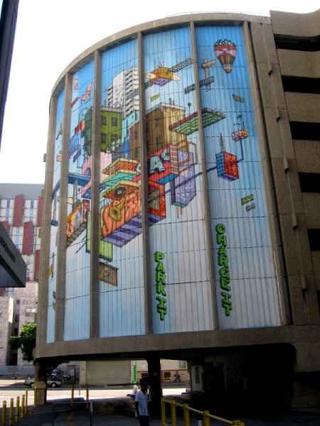 The huge cool mural wraps around the parking garage. I see a hot air balloon, phonograph, radio tower, satellite and various buildings, all interconnected like a circuit.