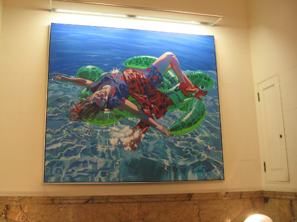 I like this cheerful painting of a girl lying on a turtle behind the hotel's front counter!