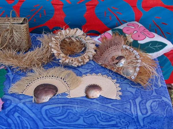 Tivaevae Polynesian quilting from the Cook Islands, finely made fans, and other handcrafted works on display.