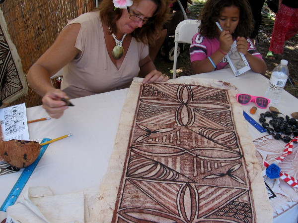 Artist representing Samoa creates Siapo, also known as tapa, using ink made from native seeds and tree bark.