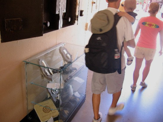 Display cases in this preserved hallway contain artifacts from local law enforcement decades ago.