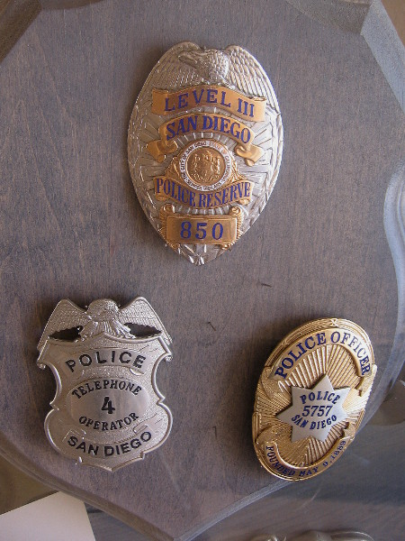 Vintage police shields and badges are among the interesting items in this museum-like display.