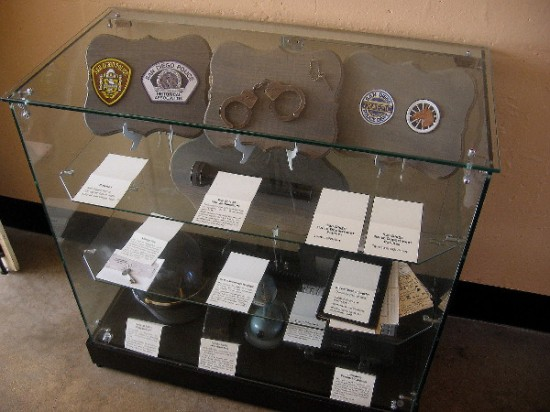 Handcuffs, documents and law enforcement equipment educate visitors about police history in San Diego.