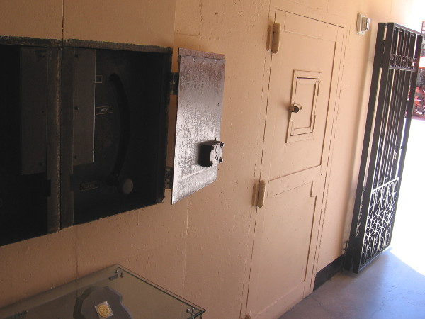 The door of a holding cell in the old police headquarters corridor.