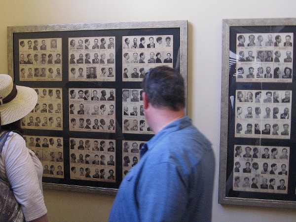 Visitors to The Headquarters old cell block look at mug shots on one wall.