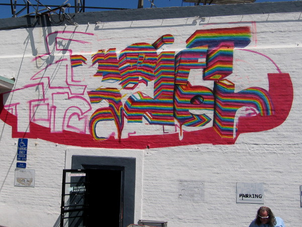 I was told by a worker at this thrift store that the rainbow-like mural is a work in progress.