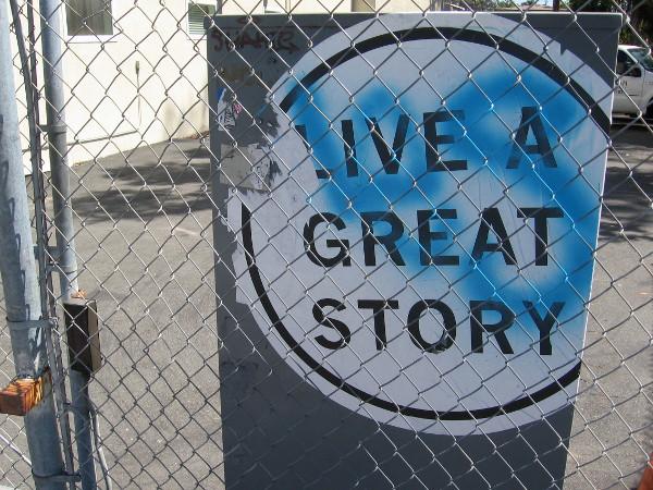 Live a great story. Sticker on a utility box.