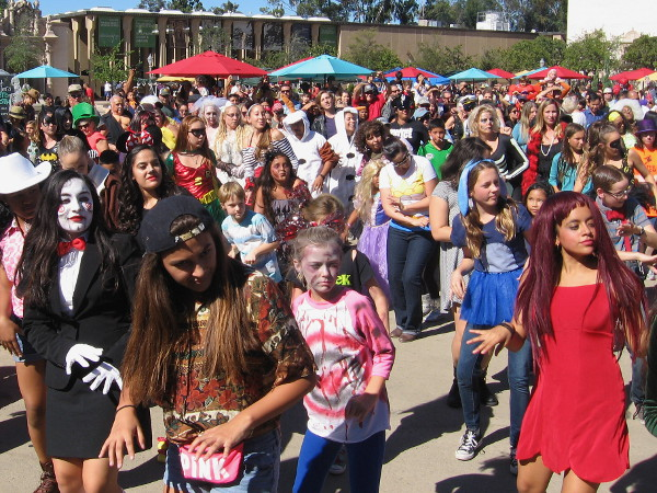 Zombies and ghouls gather for a scare at Balboa Park Halloween Family Day.