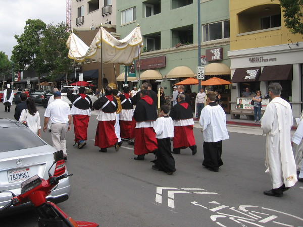 A colorful religious procession makes its way through San Diego's historic Little Italy neighborhood.