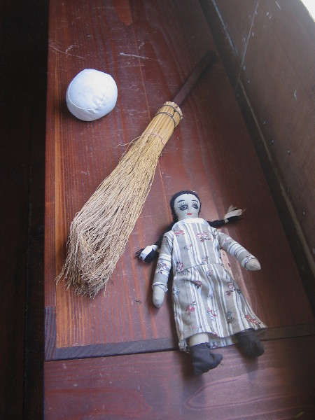 A ball, broom and doll.