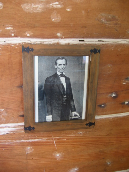 Photographic portrait of President Abraham Lincoln on a primitive wall. Mason Street School was San Diego's first schoolhouse, built in 1865 at the end of the Civil War.