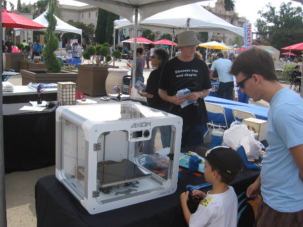 Checking out a 3D printer at the San Diego Public Library table at Maker Faire. The library is about to expand their Innovation Lab and will have nine 3D printers!