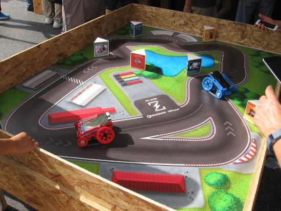 Local company Qualcomm had a large exhibit showcasing their electronic chips, some drones, and this little remote control race course which utilizes smart phones.