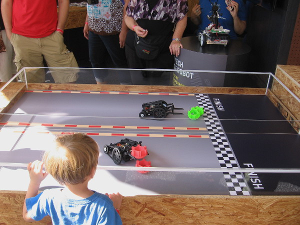Another fun part of the Qualcomm exhibit at Maker Faire. Robots stack blocks, then cross a finish line.